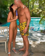 Sexy Holly Wellin plays with the dildo at the pool when guy comes to her to get a blowjob