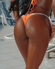 Black girl Aline shows her sexy ass and puts her bra and swimwear off at the pool